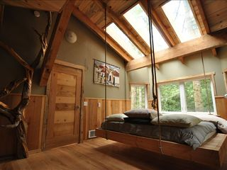 Coos Bay house photo - King size hanging bed, skylights, & juniper log ladder for the loft in bedroom