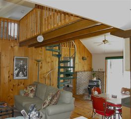 Berkeley Springs cabin photo - Spiral staircase to the upper level loft.