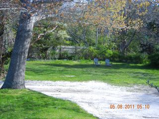 View driving down the driveway and side yard - East Orleans house vacation rental photo