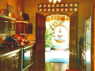 Sayulita house photo - BRIGHT FULLY EQUIPED KITCHEN LOOKING INTO BACK PATIO AND WALL FOUNTAIN