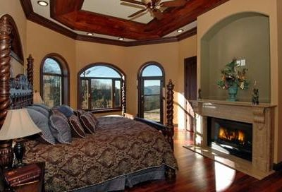 1 Master bedroom with fireplace and great views toward the mountain