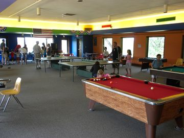 Game room at Owners Club. Steps from pool and snack bar.