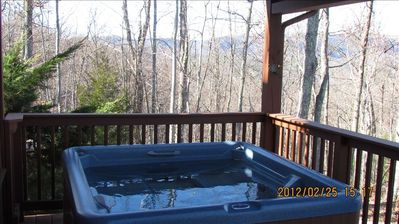 Private hot tub on covered porch