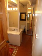 Santa Fe house photo - Middle bathroom (with tub & shower in tub).