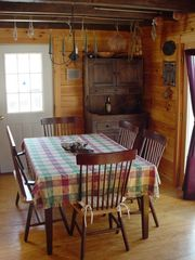 Trenton cabin photo - Dining room open to great room and french doors to deck with gas grill.