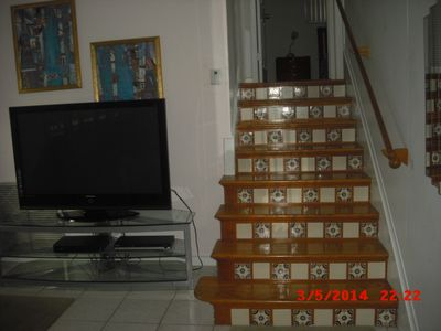 Stairs leading to 2 bedrooms & full bath.