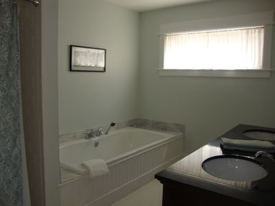 Bass Harbor house rental - Master bath with tile shower, large soaking tub, and double granite vanity.
