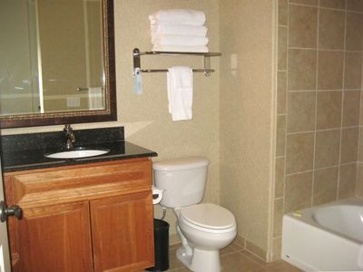 La Quinta condo rental - Bathroom with high ceilings, granite counter and tiled shower