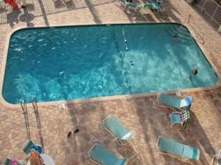 Heated Pool and Pool Deck - Clearwater Beach condo vacation rental photo