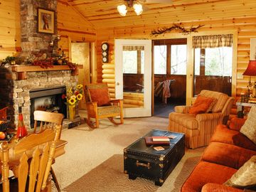 Branson cabin rental - Wonderful open living area great for gathering. TV, fireplace.