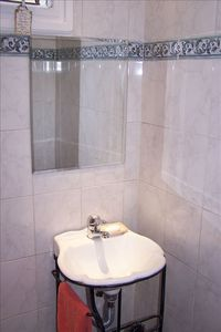 BEAUTIFULLY TILED HALF BATH LOCATED NEAR THE ENTRY