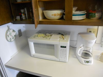 Microwave and coffee maker.