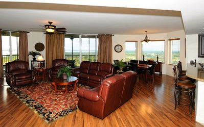 Handsome furnishings complement rich finishes and panoramic views.