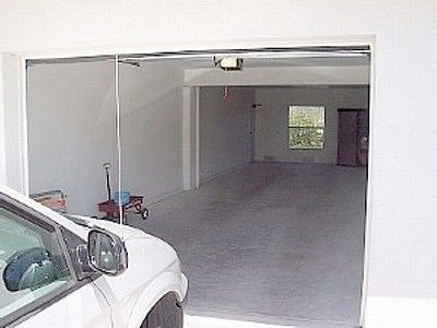 2 car enclosed garage w/beach toys & wagon