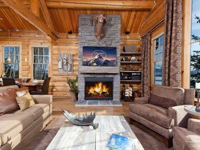 Stone woodburning fireplace, LED TV, trophy Rocky Mountain bighorn mount