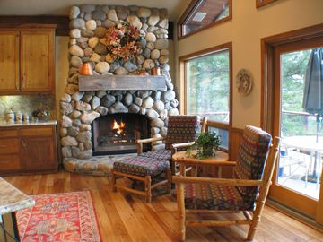 Seating area in the kitchen with gas fireplace. Cozy all year!