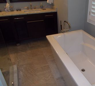 Master bath with large glass shower, expansive tub and dual vanities.