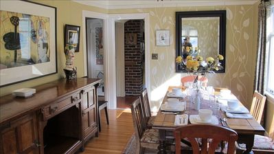 Perfect for entertaining, the dining room, with its large buffet, seats eight.