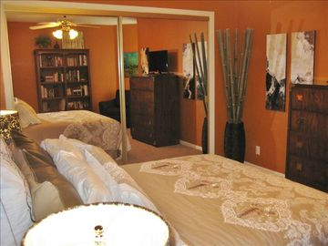 Queen bed and large closet in guest bedroom.