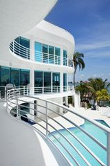St Pete Beach house photo - Back of house with floor to cieling steel ford blue glass,panoramic water view.