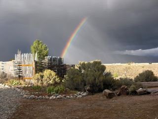Taos house photo - Rainbow + Storm + Fencing: Compound at Stargazer, Taos NM