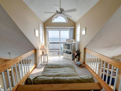 Relax in the Loft with the private deck, great views of the ocean and beach