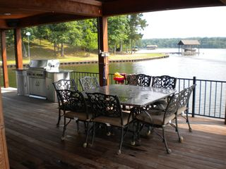 Lake Bob Sandlin lodge photo - Grill and seating for 8 on the boat dock
