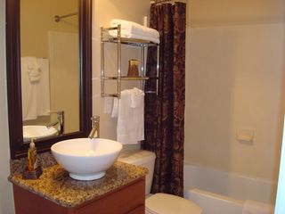 Ocean Reef condo photo - Shared bath for third and fourth bedrooms; new granite counter top and bowl basi