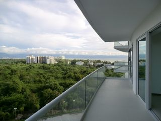 Nuevo Vallarta condo photo - View from back private balcony - overlooking the forest and ocean view.