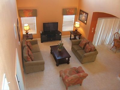 "Two story high ceiling family room with 42"" LCD TV"