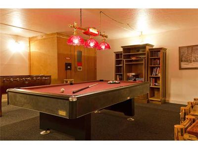 Shared game room includes pool table, foosball and sauna.