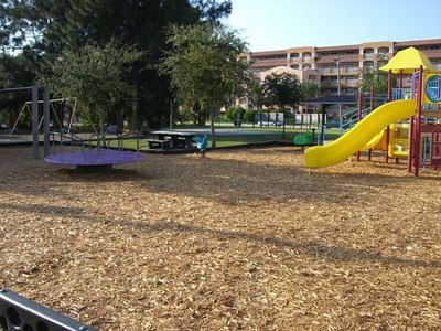 Nearby park with swings, basketball, gym and more