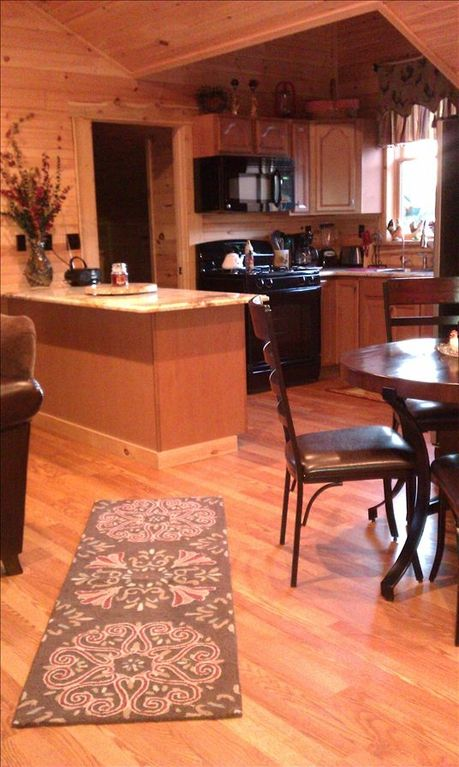 Guest House Gourmet Kitchen with granite countertops and island that seats two