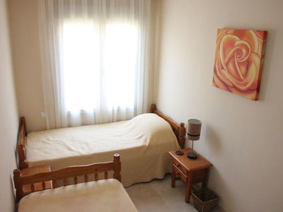 Bedroom 3 with twin beds, wardrobe and flat screen TV/DVD