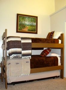 3rd bedroom with twin bunks and trundle bed-views of river
