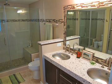 Master bthrm w duel floating vanity. Shower w wall & ceiling head - rain shower.