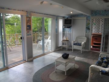 Sunroom leading to the hot tub and deck