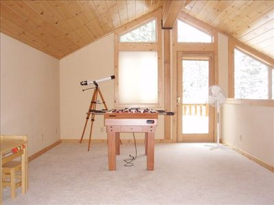 Spacious open loft with PS2 and TV set up and foosball table is ideal for kids