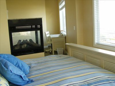 Cannon Beach house rental - Master bedroom with fireplace & bathroom in suite.
