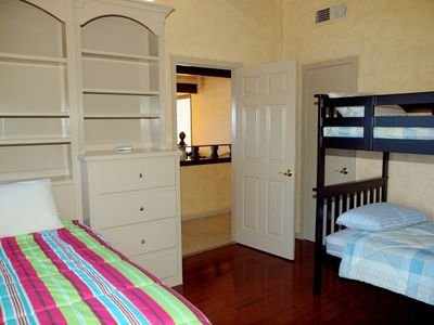 Bunk Room #2 has 1 set of bunk beds and 1 additional twin bed.