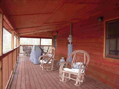Two covered decks, grill, tables and chairs are for your enjoyment