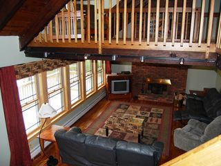 View of living room and loft from stairs from second to third floor.