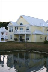Surfside Beach house photo - Back of home overlooking a lighted pond with a gorgeous water fountain.