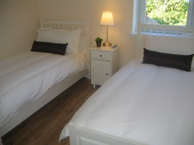 Two identical twin bedrooms