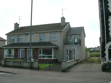 County Londonderry house rental - Front view of house. Semi detached, Mullaghard is on the right.