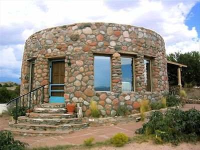 Adobe and stone casita tucked in the mesas.