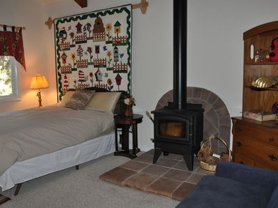Main floor guest bedroom with fireplace and french doors