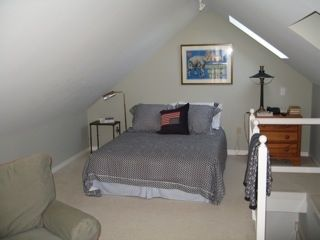 Second bedroom upstairs with queen bed