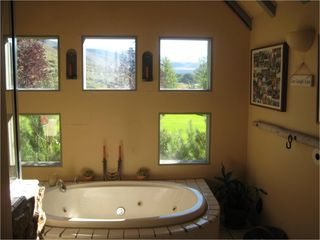 Ketchum cabin photo - Main cabin -Bathroom with jacuzzi tub, steam shower and views of Pioneer Mtns.