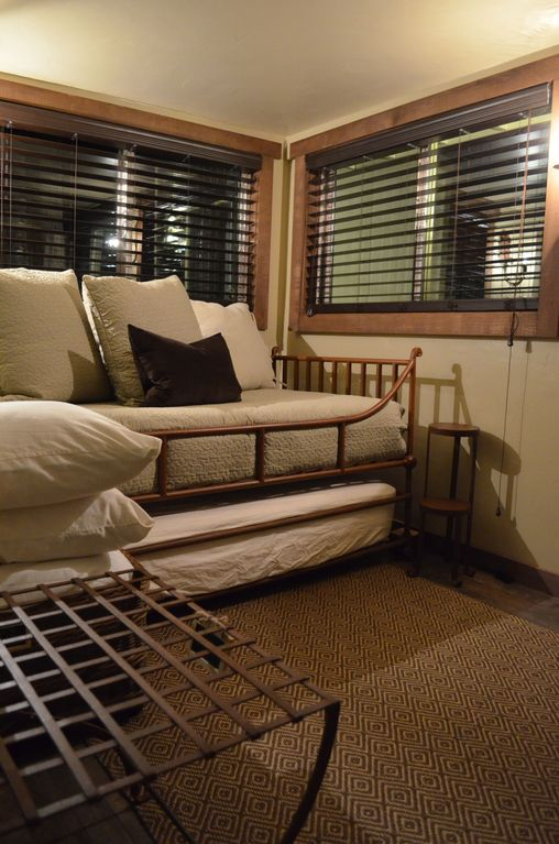 Second bedroom/media room with Daybed/Trundle Bed & Iron Luggage Rack.